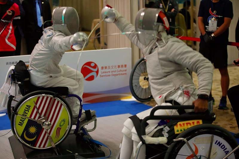 Vibhas Sen seen here wearing the GOQii band and competing with the Malaysian wheelchair Fencer at the Asian Championship in Hong Kong