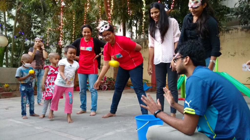 GOQii employees enjoying with the kids at Access Life