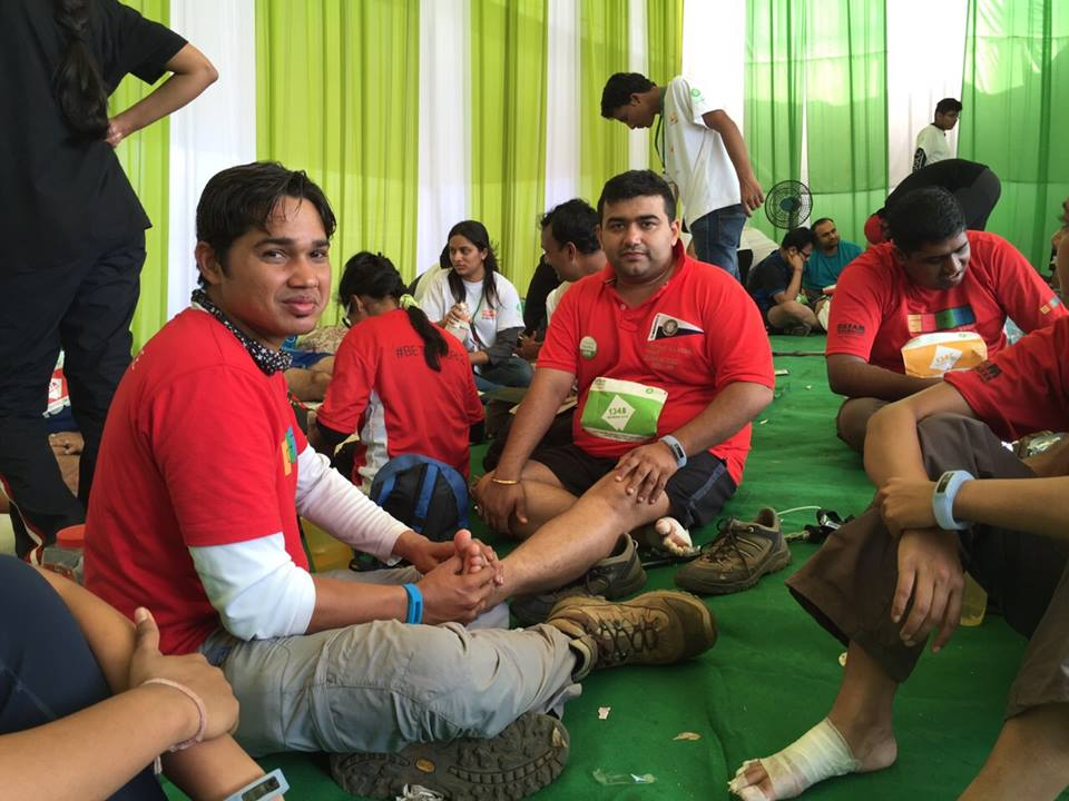 Gagan getting his legs massaged during his first Oxfam Trail walk in 2014