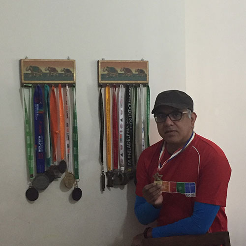 Jitu Arora with several of his Marathon medals